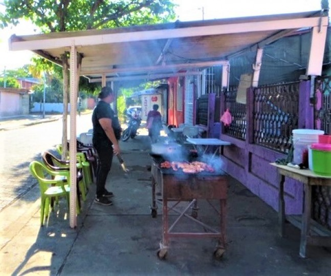Local food stands concocting delicious and aromatic foods
